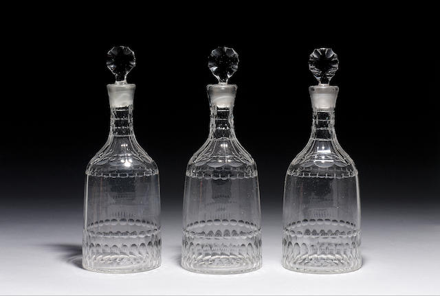 MATCHING SET OF FOUR DECANTERS STYLE OF 1760. LATE 19TH/EARLY 20th c.  THE DECANTERS ARE FACET CUT O