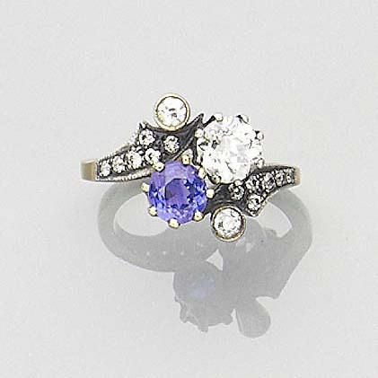 A sapphire and diamond cross-over ring