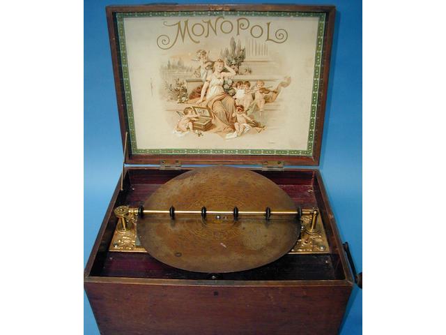 A Monopol disc musical box,