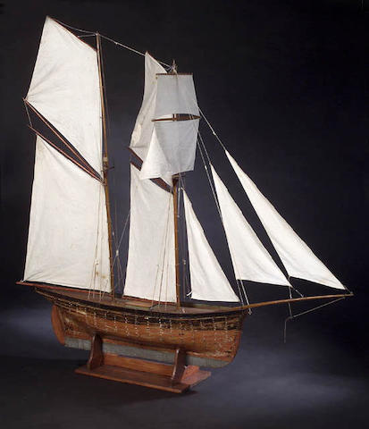 A model Pond Yacht, 'Fleetwing', a two-masted square topsail Schooner, 121.5cm long,