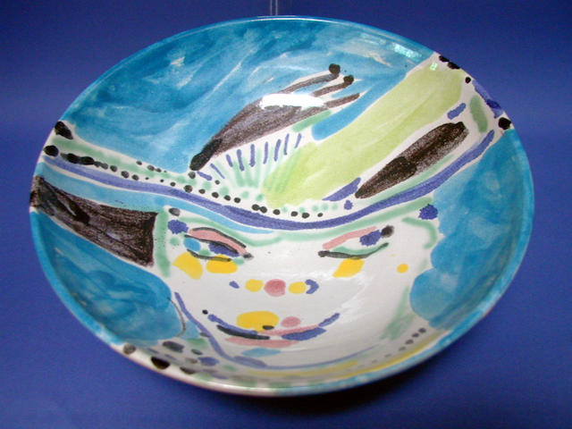 An earthenware bowl by Philip Sutton painted face design, signed, 26cm diameter.