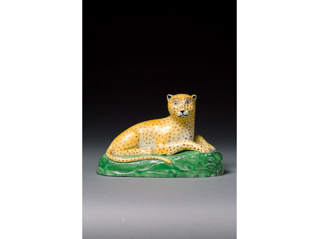 A fine and rare creamware model of a leopard circa 1800