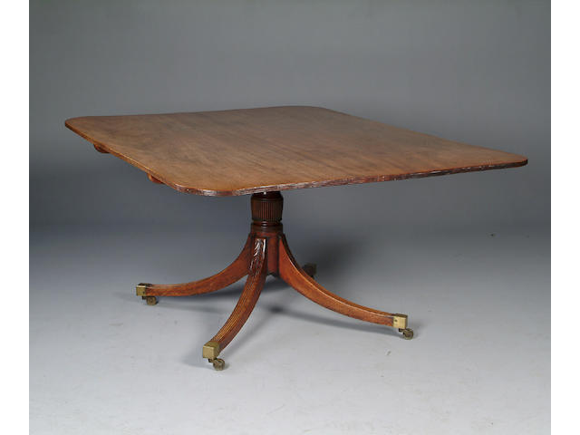 A George III mahogany breakfast table,