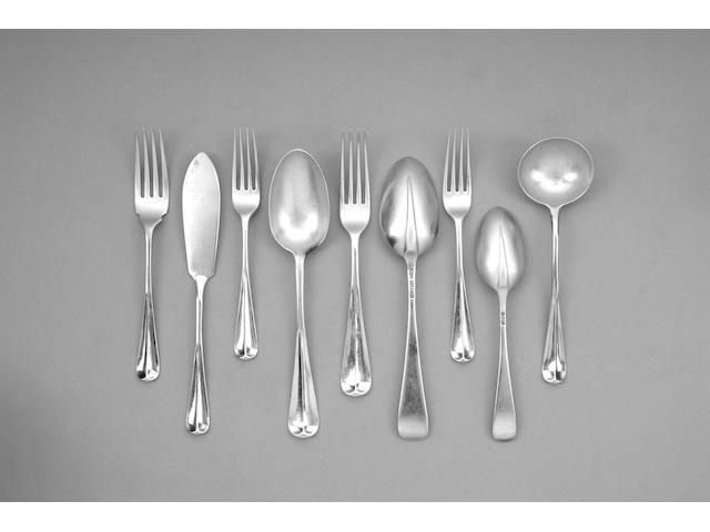 A Victorian silver Hanoverian variant rat-tail pattern table service of flatware, by Thomas Alfred Slater, Walter Brindsley Slater & Henry Arthur Holland, London 1899,