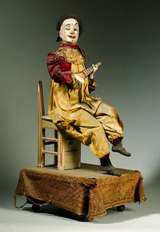 A Gustave Vichy musical automaton of a clown playing a banjo, French circa 1870