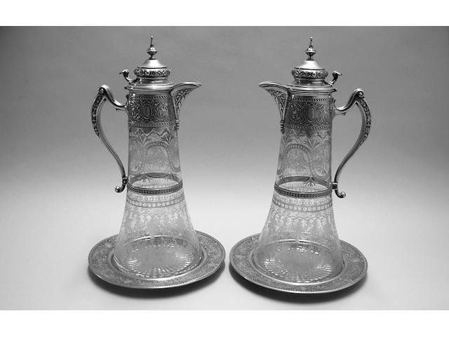 FINE SILVER  Pair of continental and glass claret jugs and stands