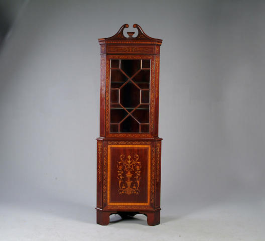 An Edwardian marquetry two tier corner display cabinet