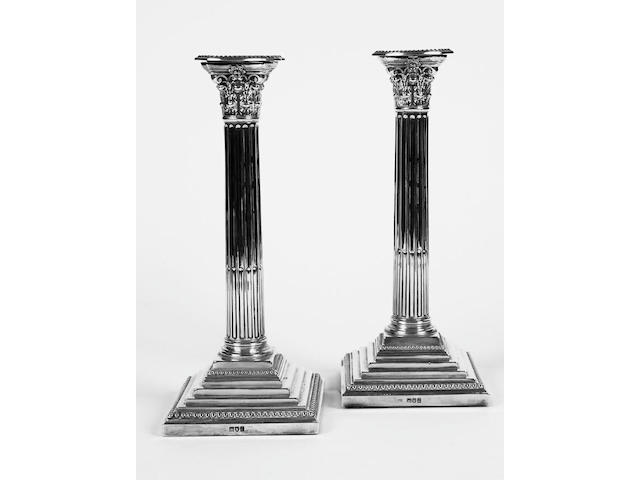 Pair of corinthian candle sticks