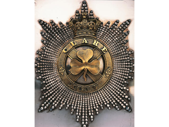 A fine mid 19th Century Irish Militia Officer's shoulder belt plate of the Clare Militia, the silvered plate with beaded star applied with a gilt crowned disc titled CLARE & XCIV, the regiment's precedence number, the disc centred by a cut-out saltyre superimposed with a shamrock, original leather backing intact.