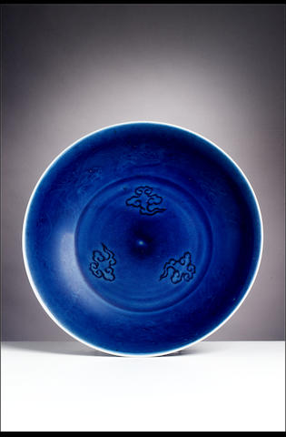 A blue-glazed 'dragon' saucer dish Xuande six-character mark, Kangxi period