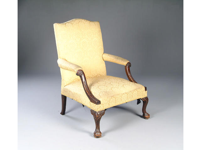 A George III mahogany Gainsborough style library chair