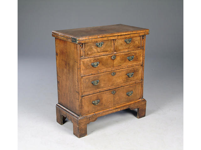 A George I style walnut bachelor's chest 67 cms wide x 36 cms deep x 76 cms high