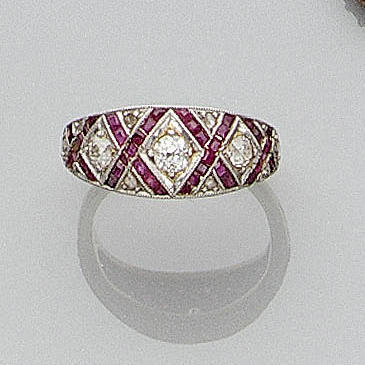 An art deco ruby and diamond band ring,