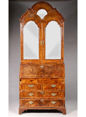An early 18th Century Dutch walnut featherstrung and crossbanded bureau cabinet,