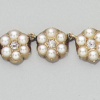 A mid Victorian pearl and diamond cluster necklace