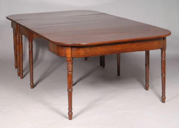 A Regency mahogany and ebony strung D-end dining table,