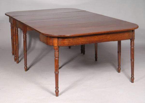 A Regency mahogany and ebony strung D-end dining table,