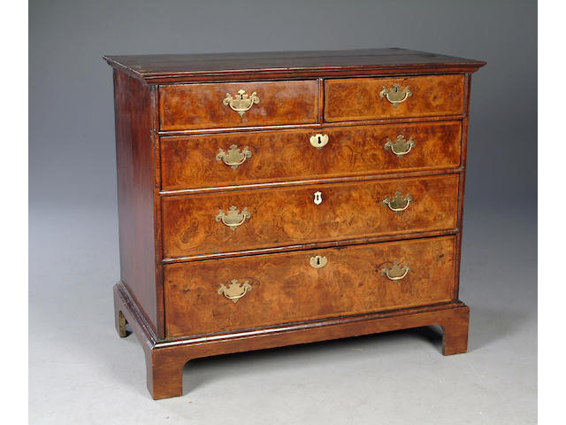 An early 18th century walnut and feather banded chest of drawers