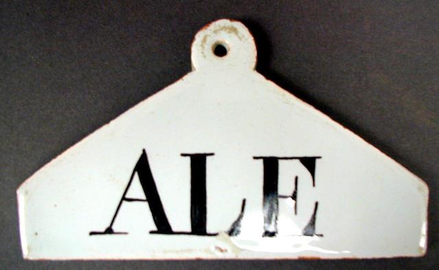 A Delftware glazed bin label,