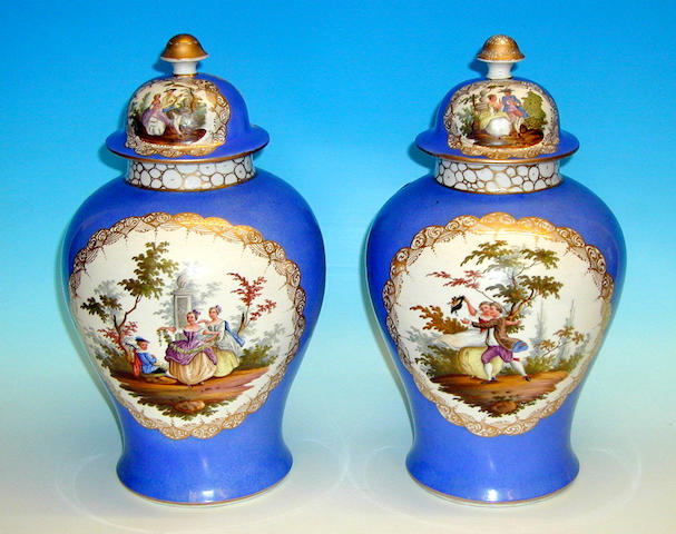 A pair of Dresden vases and covers,