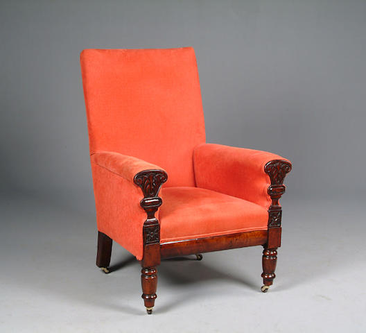 A William IV mahogany framed library chair with acanthus leaf and paterie carved decoration