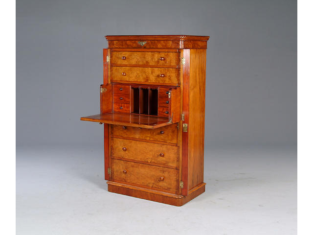 A Victorian walnut secretaire wellington chest.
