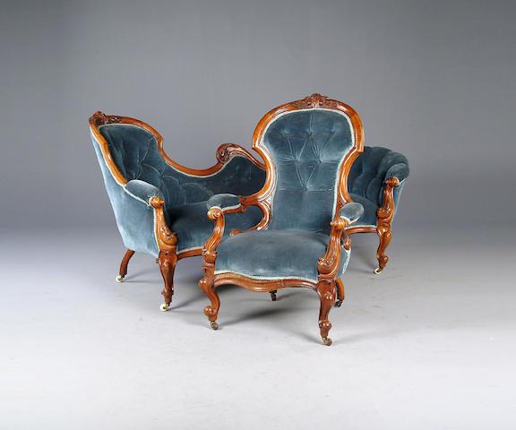 A Victorian walnut nine piece parlour suite,