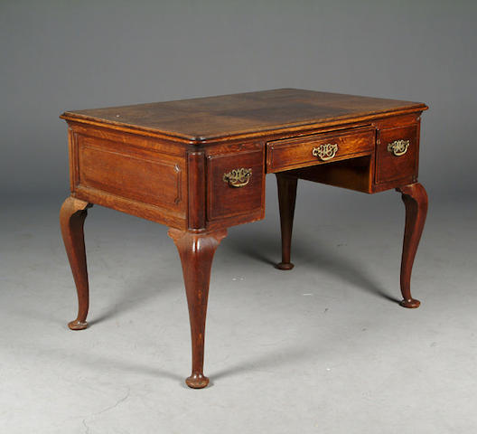 An Edwardian oak writing table,
