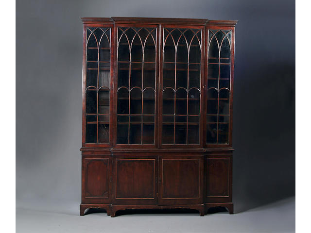 A George III style mahogany breakfront libray bookcase