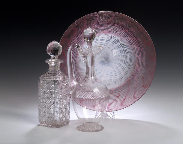 A cut glass decanter and a cut glass jug,
