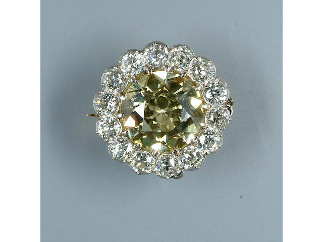 A yellow diamond cluster brooch