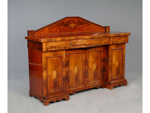 An Edwardian mahogany and marquetry inlaid twin pedestal sideboard