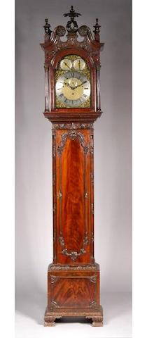 Waring and Gillow, London, an Edwardian carved mahogany longcase clock,