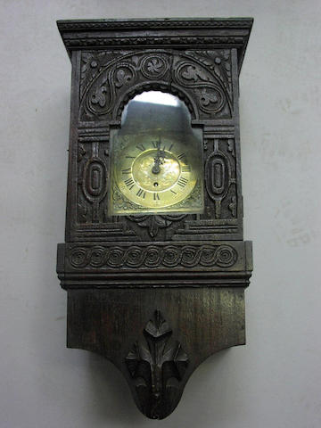 A 19th century carved oak wall clock,