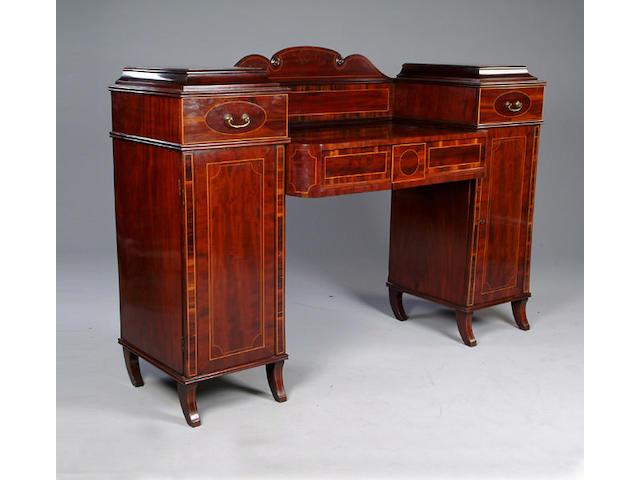An Edwardian Regency style mahogany twin pedestal sideboard