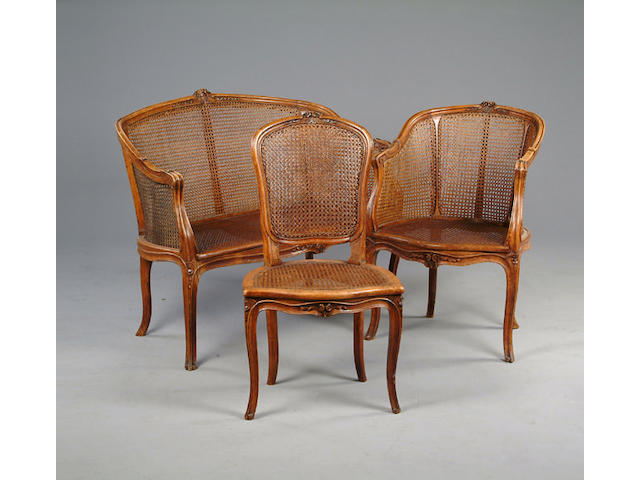 A late 19th century carved and caned beech salon suite