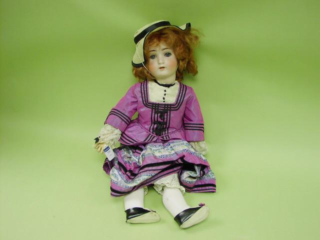 An A.B.G bisque head doll, circa 1910