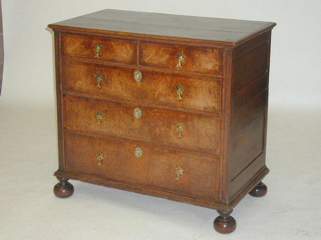 A Charles II oak and walnut veneered chest,