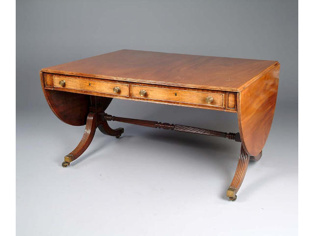 A Regency style mahogany sofa table of large proportions