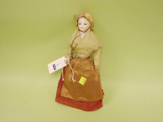 A bisque shoulder head doll, circa 1890