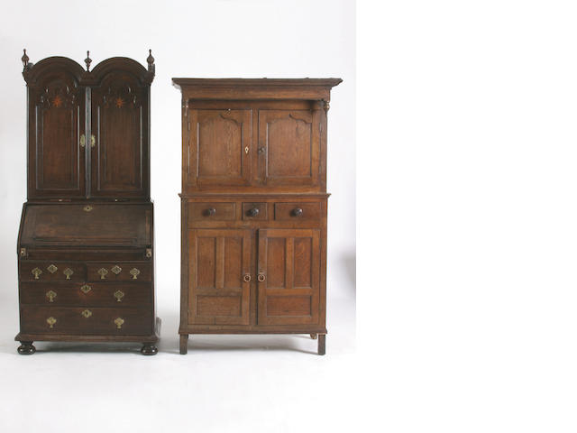 An 18th Century oak bureau cabinet,