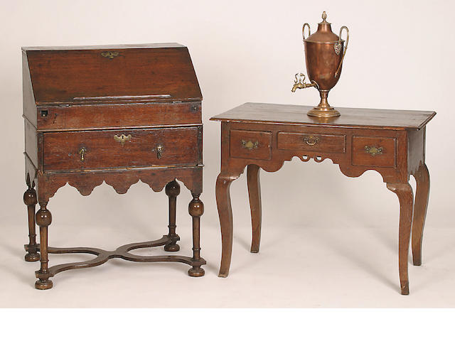 A late 17th Century oak bureau on stand,