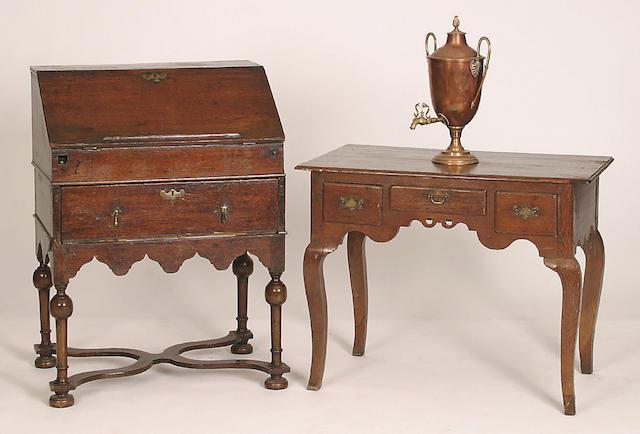 A late 17th Century oak bureau on stand,