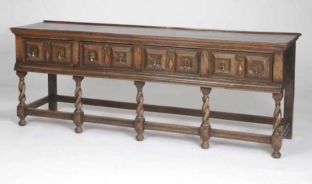 An early 18th Century and later oak low dresser,