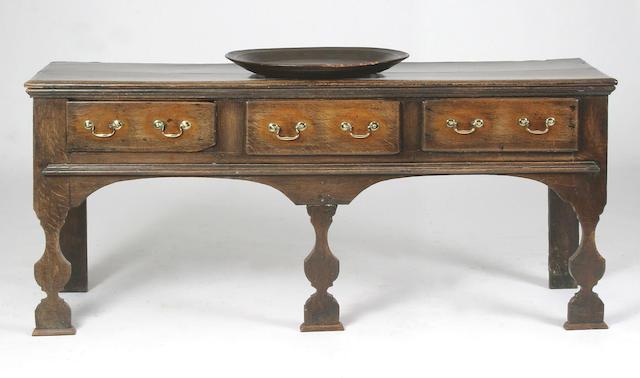An early 18th century oak low dresser, Welsh,