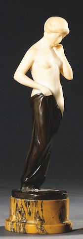 An early 20th century French carved alabaster and bronze figure of a semi-clad maiden