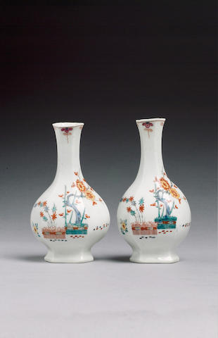 A pair of Worcester hexagonal bottle vases painted with banded hedges , pine and bamboo, 11.2cm.