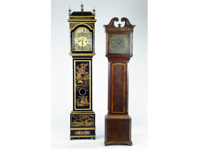 A black lacquered longcase clock Dial 35cm, 240cm high.