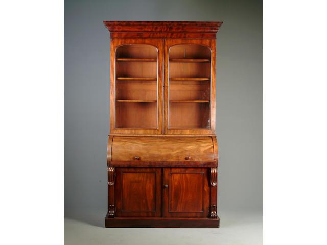 A Victorian mahogany roll top bureau bookcase