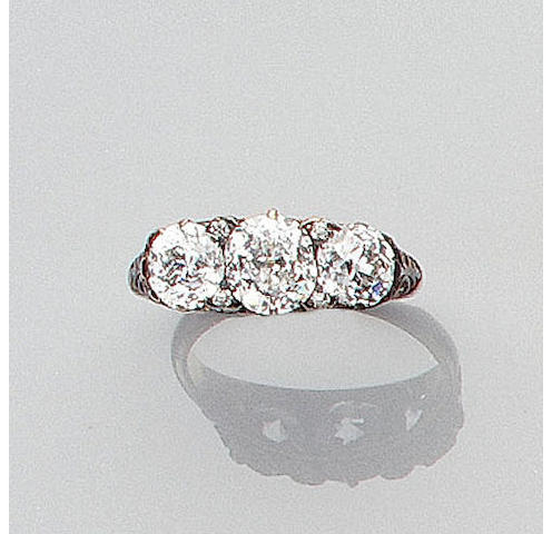 A late Victorian diamond three-stone ring